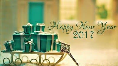 Happy New Year 2017 with green color gift boxes