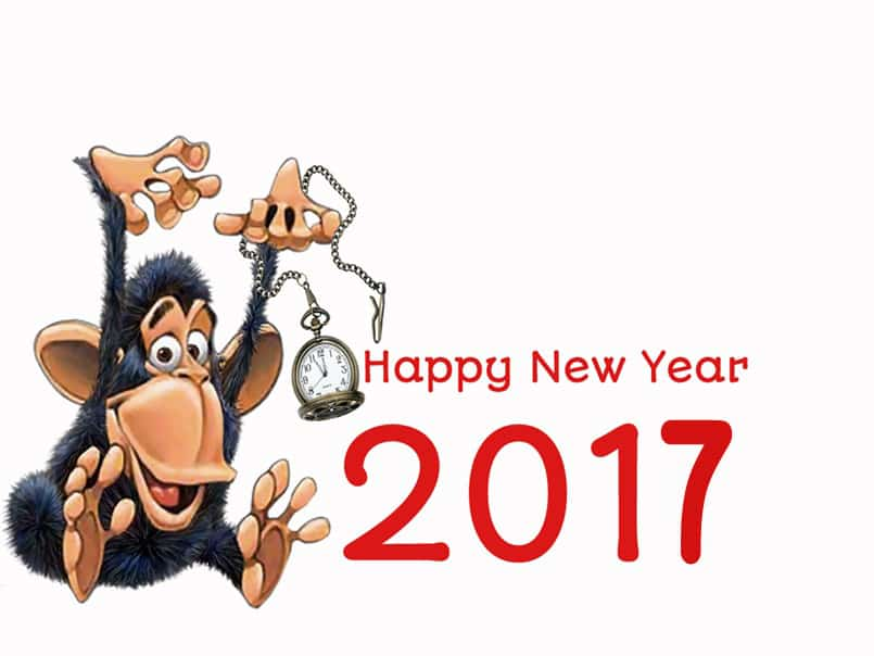 Happy New Year 2017 with monkey holding a clock
