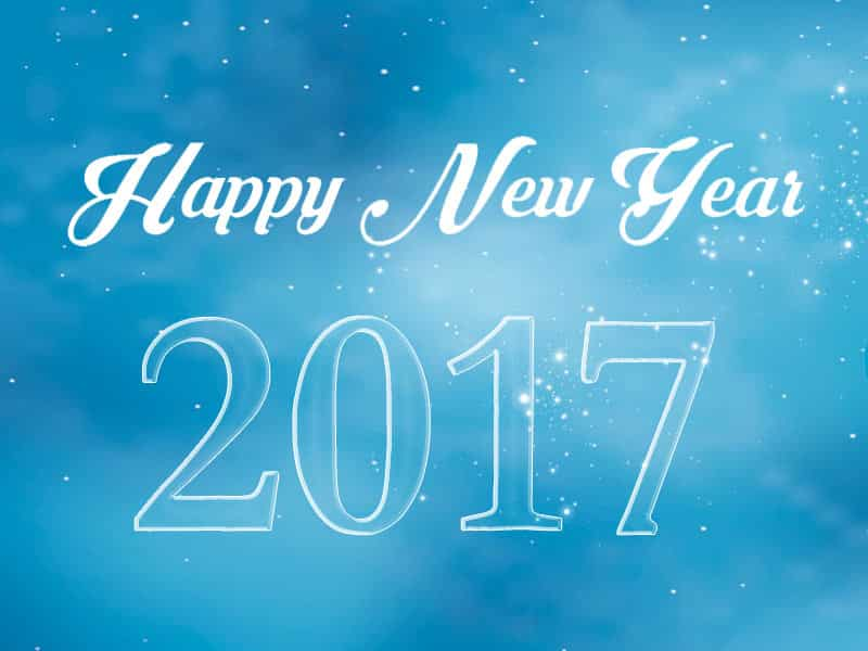 Happy New Year 2017 with snowfall and blue background