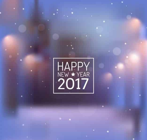 Happy New Year 2017 with snowfall and star